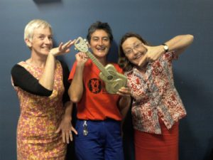 The 2011 Melbourne Ukulele Festival Golden Ukulele - held by Rosina, touched by Danielle, pointed at by Dianne.