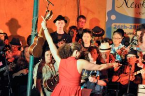 Jane conducting the UUU at the Newkulele Festival